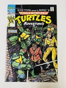 Teenage Mutant Ninja Turtles Adventures #1 NM- Pressed & Ready to Grade!