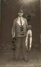 WW1 wounded soldier hospital blues Military Police fisherman with large Pike ?