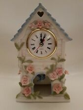 Porcelain Musical Mantle Clock With A Blue Bird Swinging Pendant