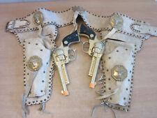 Vintage Hubley Texan Jr Western pair toy cap gun revolvers, leather fringe belt