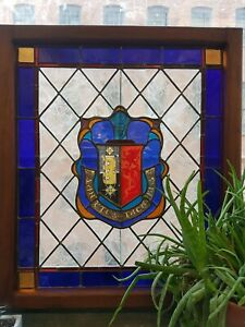 Restored antique medallion stained glass window