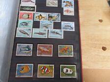 A4 thème poissons 20 timbres oblitérés tous états voir photos dont commores