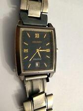 Orient watch Titanium Quartz date indicator water resistant.