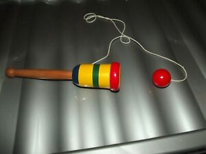 wooden ball in a cup game