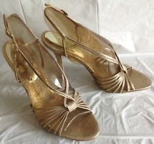 NWOB, Guess heels, Hutton 2 design name, antique gold,man made material, size 8M