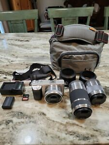 Sony Alpha a6000 Mirrorless Digital Camera Silver w/ three lenses (SEL50F18)