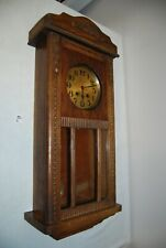 E1 Ancienne horloge murale - bois -
