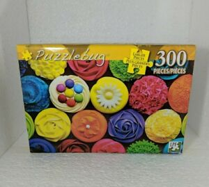 New Puzzlebug 300 Piece puzzle features Rainbow Cupcakes Factory Sealed