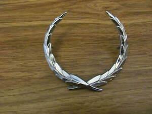 67-70 Cadillac Eldorado TRUNK LOCK WREATH