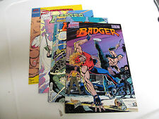 Lot 4 *First Comics* Badger* 1986.# 9 & # 11. F/F.1987 # 28 & # 29 F/F