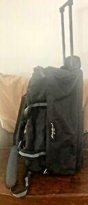 Eddie BAUER Black Canvas Duffel Bag w/ Rollers or carry on w/ Shoulder Strap.