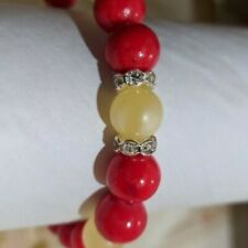 Bracelet made of coral and Baltic amber on a rubber band.
