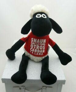 Famosa Shaun le mouton noir et rouge inscription espagnole velours 49 cm env