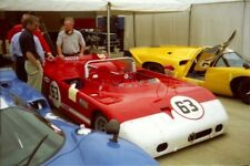PHOTO  BOBBY BELL'S ALFA ROMEO 33TT3 IS SANDWICHED BETWEEN THE LOLA T70 MK3BS OF