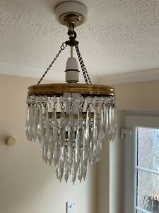Chandelier light shade. Glass three tier. Currently working
