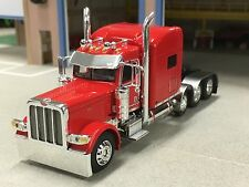 1/64 DCP RED 389 PETERBILT TRI-AXLE
