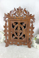 Antique black forest wood carved apothecary wall cabinet pipes tobacco