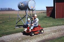 1969 COLOR SLIDE 756 Urbana Ohio Hunt Farm Children on Lawnmower Kiebler