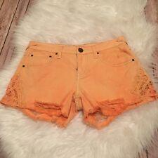 Women's Free people Denim And Lace orange distressed cutoff shorts Size 26