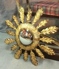 Glace / miroir soleil en tôle dorée avec oeil de sorcière style Années 1970