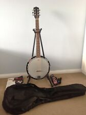 6-string guitar banjo plus stand, strap, case and instruction book with CD