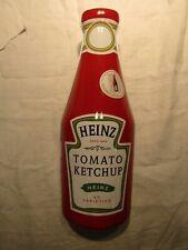 LARGE HEINZ TOMATO KETCHUP SAUCE TIN WITH A HEINZ TEA TOWEL INSIDE