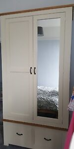 PAINTED WARDROBE WITH RUSTIC TOP AND TRIM AND MIRRORED DOOR MADE TO MEASURE
