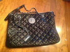 DKNY black quilted leather shoulder bag/tote with zippered closure & flannel bag