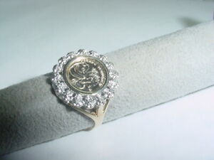 14807  womans 10 kt. y/g replica panda coin ring accented by 8 melee diamonds.