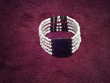 PRETTY BANGLE/BRACELET WITH WOODEN CENTRE SQUARE AND WHITE BEADS