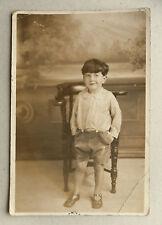 1927 B/W Photograph. Cheeky Young Boy in Shirt Buttoned to Shorts. Seaside?