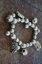 Silver tone soccer inspired stretch charm bracelet, signed Best