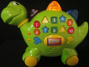 Green English Spanish Dinosaur Toy Lights Sounds Numbers Colors Shapes Music