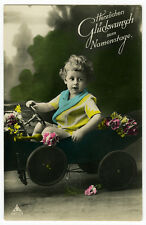 1920s Vintage child kids CHILD IN PEDDLE CAR tinted photo postcard