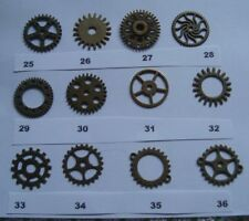 6 STEAMPUNK COGS AND GEARS ALL ARE 25mm  AND THE ALLOY IS  ANTIQUE BRONZE