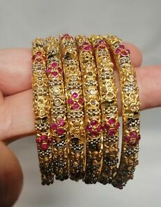 Pakistani 6 Piece Gold Bangles  With Jarao Stones In Red And White. Size 2.10