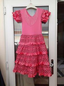 A GIRLS PINK SPANISH FLAMENCO DRESS AGE 7-8 YEARS