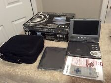 "SeViC Systems Vision Liberty Compact7 7"" DVD/MPEG4 Player. Portable Or Back Seat"