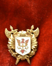 GOLD TONE AND ENAMEL GRIFFIN  W CROSS WINGS  PIN