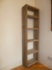 Solid wood shelving made from reclaimed scaffold boards finished in medium oak.