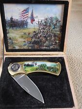 A beautiful Commerative ACW  knife in a wooden box with artwork by Dale Gallon