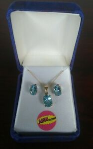 New with tags. 10k gold blue topaz earrings and necklace set. 3.06 T.G.W.