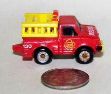 Small Micro Machine Datsun Fire Truck in Red marked Rescue with Yellow Ladders