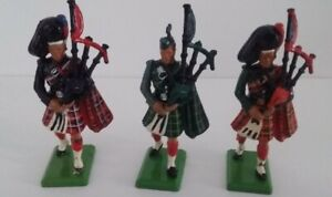 3 different Scottish Pipers, from W. Britains 54mm, made in England. MAGNIFICENT