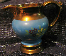 Gorgeous Blue and Brown pottery jug with floral design approx 5ins tall