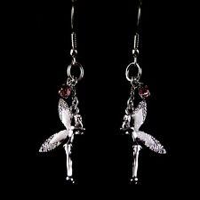 Silver and white enamel fairy dangle earrings