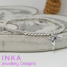 Inka 925 Sterling Silver stretch beaded Stacking Bracelet with Hummingbird charm