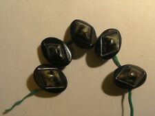 Five Vintage Buttons Made of Bakelite.Black with a marbled inlay design.