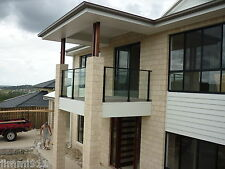 GLASS BALCONY  BALUSTRADE IN SATIN BLACK  WITH OVAL TOP RAIL AND ROUND POSTS