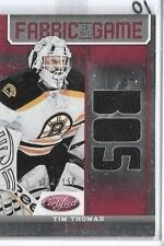 TIM THOMAS 2012-13 PANINI CERTIFIED FABRIC OF THE GAME TRIPLE GAME JERSEY#150